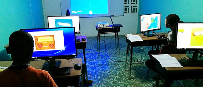 Student at the front of Ricks Building